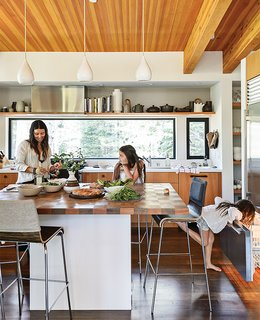 20 Best Modern Kitchen Counters - Photo 2 of 20 - In the kitchen, designer Maca Huneeus prepares lunch with her daughters Ema, 12, and Ofelia, 7. The pendants are Jonathan Adler; the island is a custom design, inspired by a 1960s Dansk tray that belonged to Huneeus's mother. The barstools are from Blu Dot.