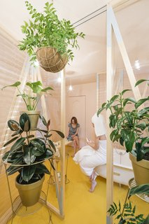 A Quirky Renovation Brings an Indoor Garden to the Center of Madrid - Photo 1 of 6 - A canary yellow–floored bathroom with corrugated plastic walls is the centerpiece of the renovation.