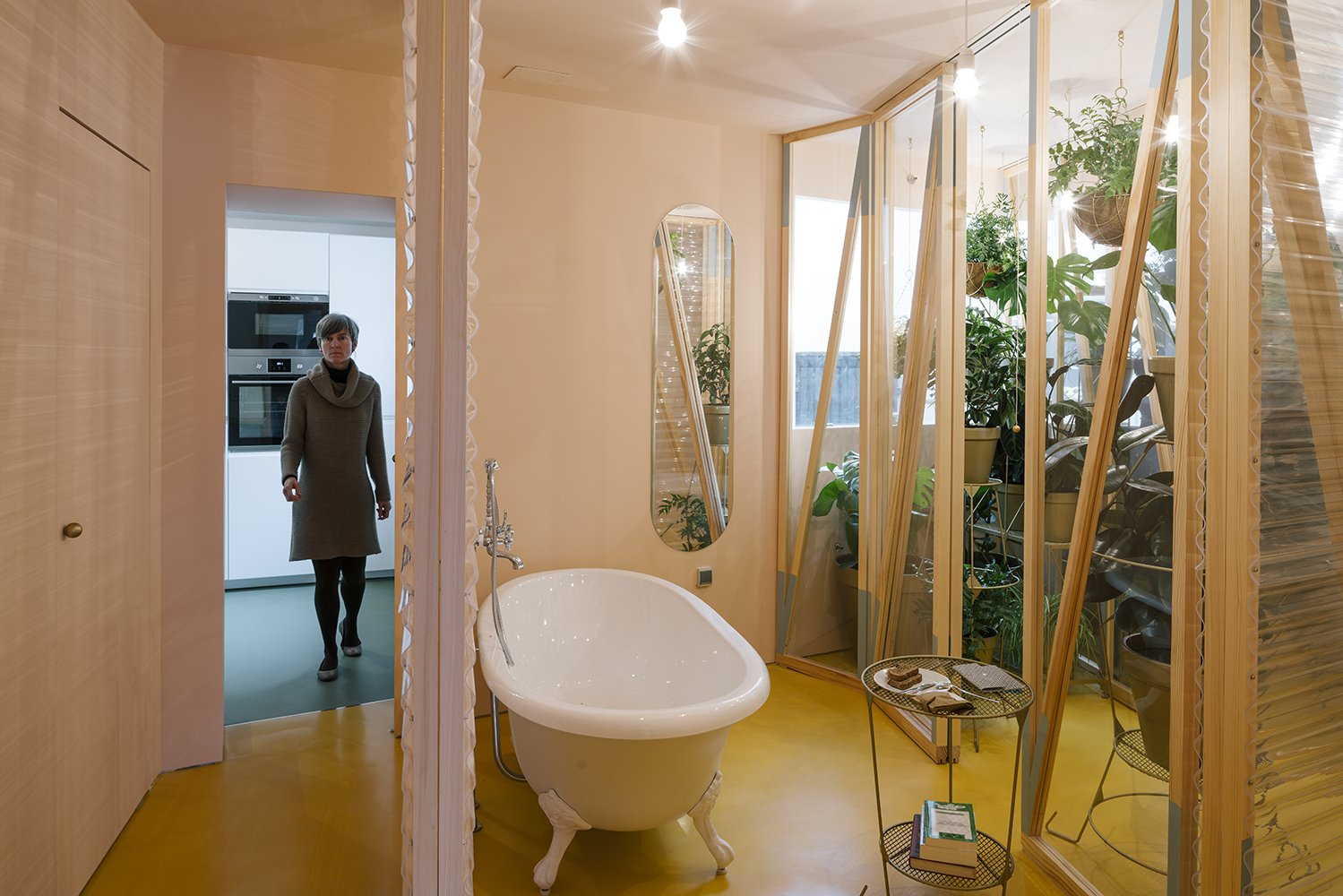 The bathroom is located at the heart of the apartment, with sliding plastic doors of varying transparency that can be moved into a number configurations. A Quirky Renovation Brings an Indoor Garden to the Center of Madrid - Photo 6 of 7