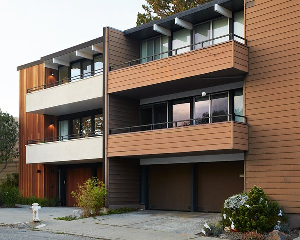 The new house, at left, still complements the neighboring unit, while introducing a clean, modern palette.