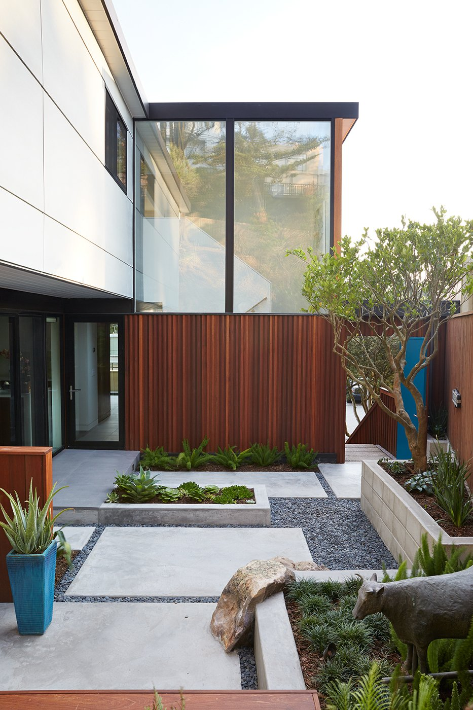 Outer Space Landscape Architects refreshed the courtyard with new hardscaping. Tagged: Outdoor, Small Patio, Porch, Deck, Pavers Patio, Porch, Deck, and Back Yard.  Midcentury Homes by Dwell from Not the Eichler Post-and-Beam Style You Know