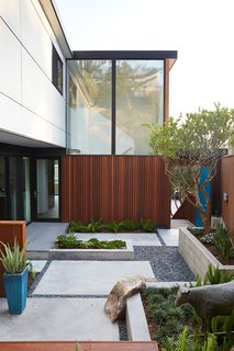 Not the Eichler Post-and-Beam Style You Know - Photo 6 of 7 - Outer Space Landscape Architects refreshed the courtyard with new hardscaping.