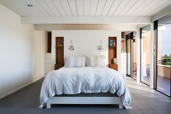 The design team decided to combine two smaller bedrooms into one more comfortable master suite with a large closet and dressing area. They also eliminated a fourth bedroom, further improving the circulation of the house. Tagged: Bedroom and Bed.  Bathroom by anne nguyen from Not the Eichler Post-and-Beam Style You Know