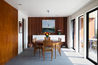 8 Bright and Airy Wood-Paneled Spaces - Photo 2 of 8 - In a 1962 Eichler house in San Francisco, original mahogany paneling was reused throughout the house to maintain its original design intent. However, the paneling was updated by keeping walls and ceilings a crisp white.