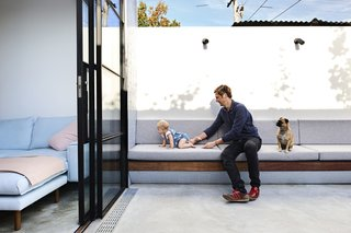 It Looks Like a Playland but This Home Works Hard - Photo 2 of 10 - The concrete courtyard offers the family, who four months ago welcomed a daughter, the option to extend their living space outdoors.