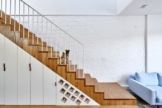 It Looks Like a Playland but This Home Works Hard - Photo 4 of 10 - Each inch is accounted for in the 1,916-square-foot home. Cabinets and clever storage for wine are tucked under the stairs.