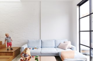 It Looks Like a Playland but This Home Works Hard - Photo 5 of 10 - Gayfer turned the home's greatest weakness, its compact size, into an advantage by encouraging interaction. Ledges, benches, and built-ins were placed tactically to promote conversation. The Errol sofa is by Jardan.