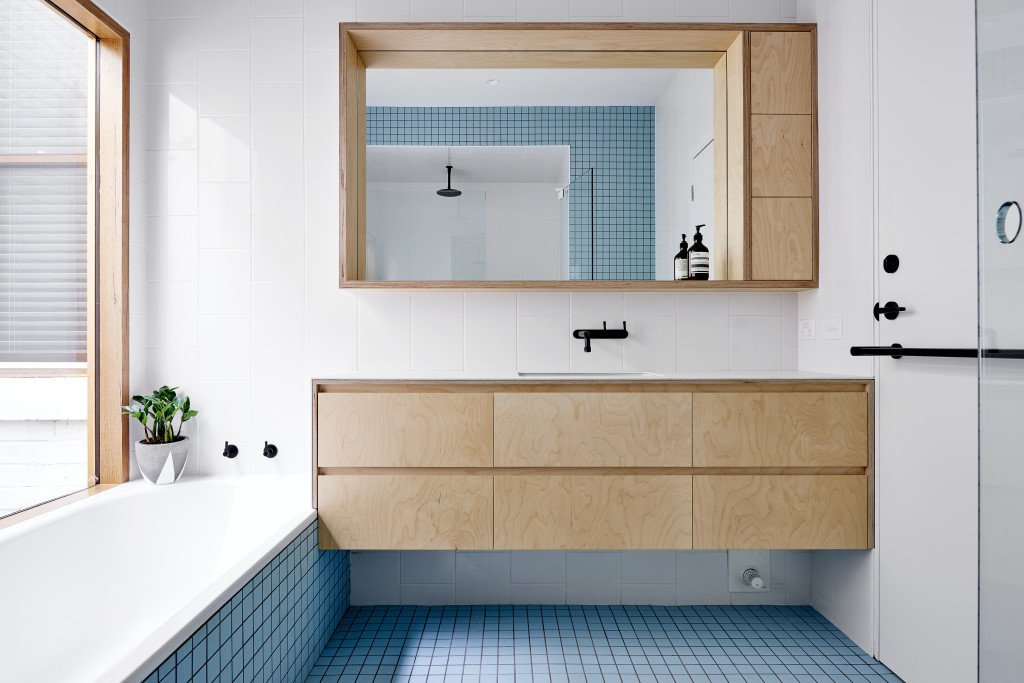 Each of the home's bathrooms displays a different eye-catching shade of tile from Inax, such as baby blue.  Photo 8 of 11 in It Looks Like a Playland but This Home Works Hard