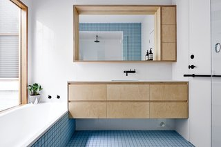 It Looks Like a Playland but This Home Works Hard - Photo 7 of 10 - Each of the home's bathrooms displays a different eye-catching shade of tile from Inax, such as baby blue.