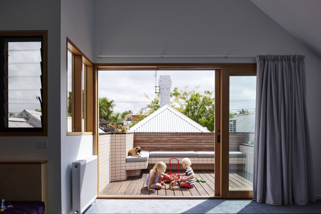 A small roof terrace offers a second outdoor enclave for play.  Photo 10 of 11 in It Looks Like a Playland but This Home Works Hard