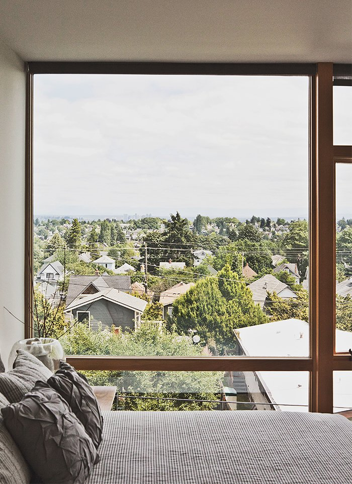 The third-floor master bedroom boasts sweeping views of Seattle.