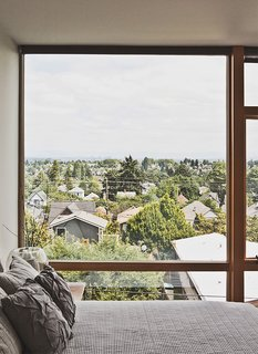Three Families Comfortably Fit in One Slim Lot - Photo 4 of 11 - The third-floor master bedroom boasts sweeping views of Seattle.