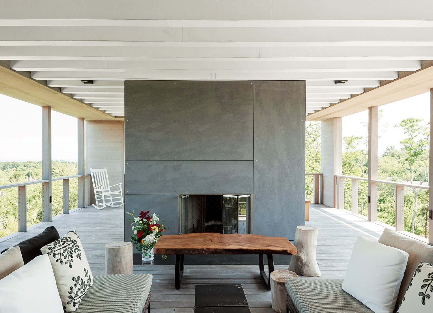 On the rooftop deck is an outdoor fireplace clad in cement board panels, plus a custom wych elm table by Arnold d'Epagnier and Charles Outdoor sofas by B&B Italia.  Photo 11 of 12 in The Soothing Sounds of Nature Fill Up This Island Prefab