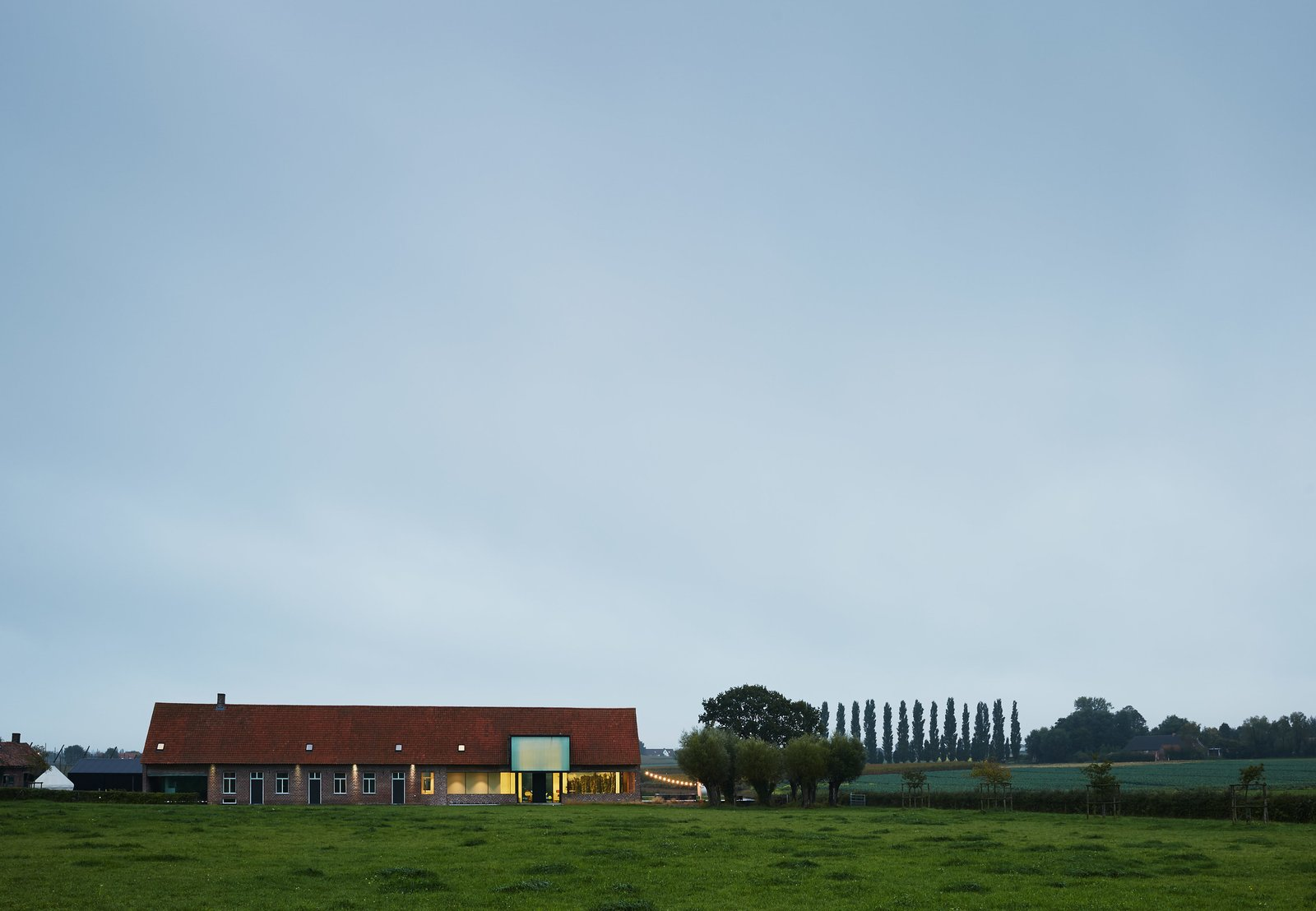 """If you want to respect the old, the contrast should be brutal. I want to be very clear what is old and what is new."" —Dirk Wynants Tagged: Exterior, House, Gable RoofLine, Brick Siding Material, and Shingles Roof Material.  Photo 2 of 11 in A Kubrick-Esque Farmhouse Kicks Its Fossil Fuel Habit"