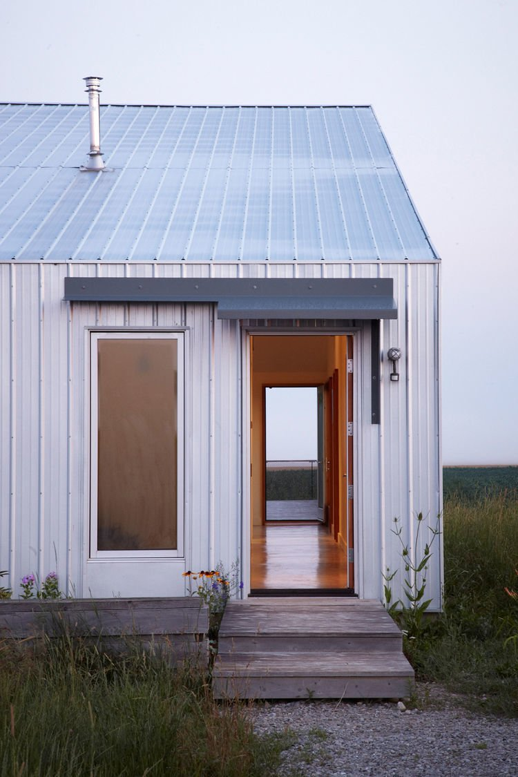 """""""There's a presence to that place—it's vast, and constantly shifting,"""" Moffitt says. """"It was clear that this house should be an observation shed for the changing landscape beyond."""" Tagged: Exterior, Metal Siding Material, and Gable RoofLine.  Photo 11 of 11 in An Off-Grid Home That Relies on the Sun and the Wind"""