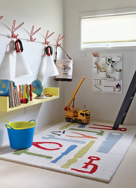 he boys' playroom is outfitted with a Uten.Silo wall organizer by Dorothee Becker for Vitra and a pair of May Day lamps by Konstantin Grcic for Flos that dangle from a set of Peace hooks by Louise Hederström for Maze.