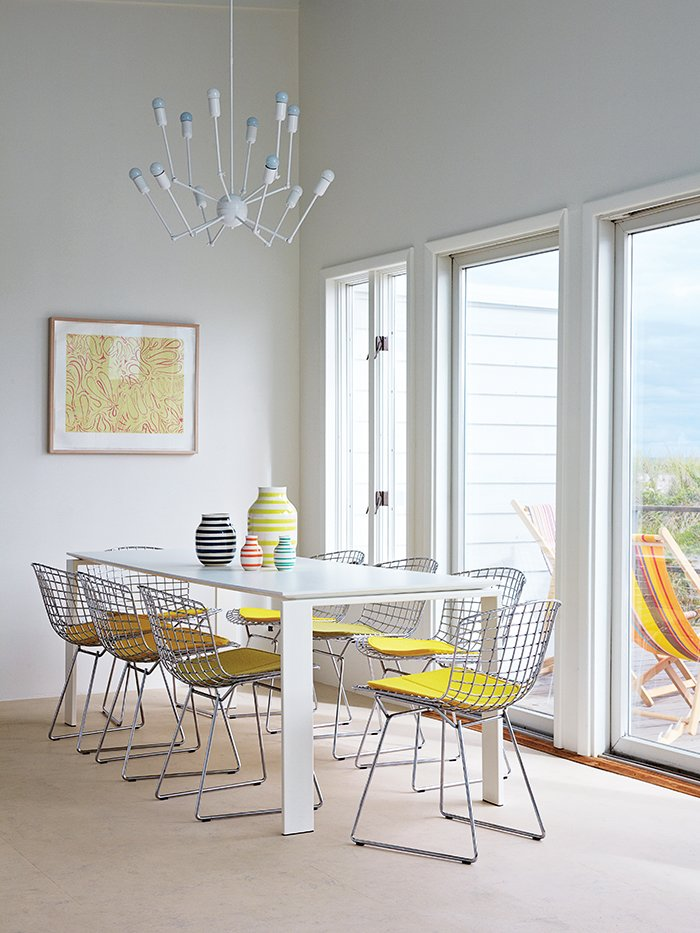 A Single Octopus chandelier by Autoban hangs above a Four dining table by Ferruccio Laviani for Kartell and a set of side chairs by Harry Bertoia for Knoll. Tagged: Dining Room, Chair, Bench, and Pendant Lighting.  Photo 6 of 9 in How a Smart Interior Design Saved This House