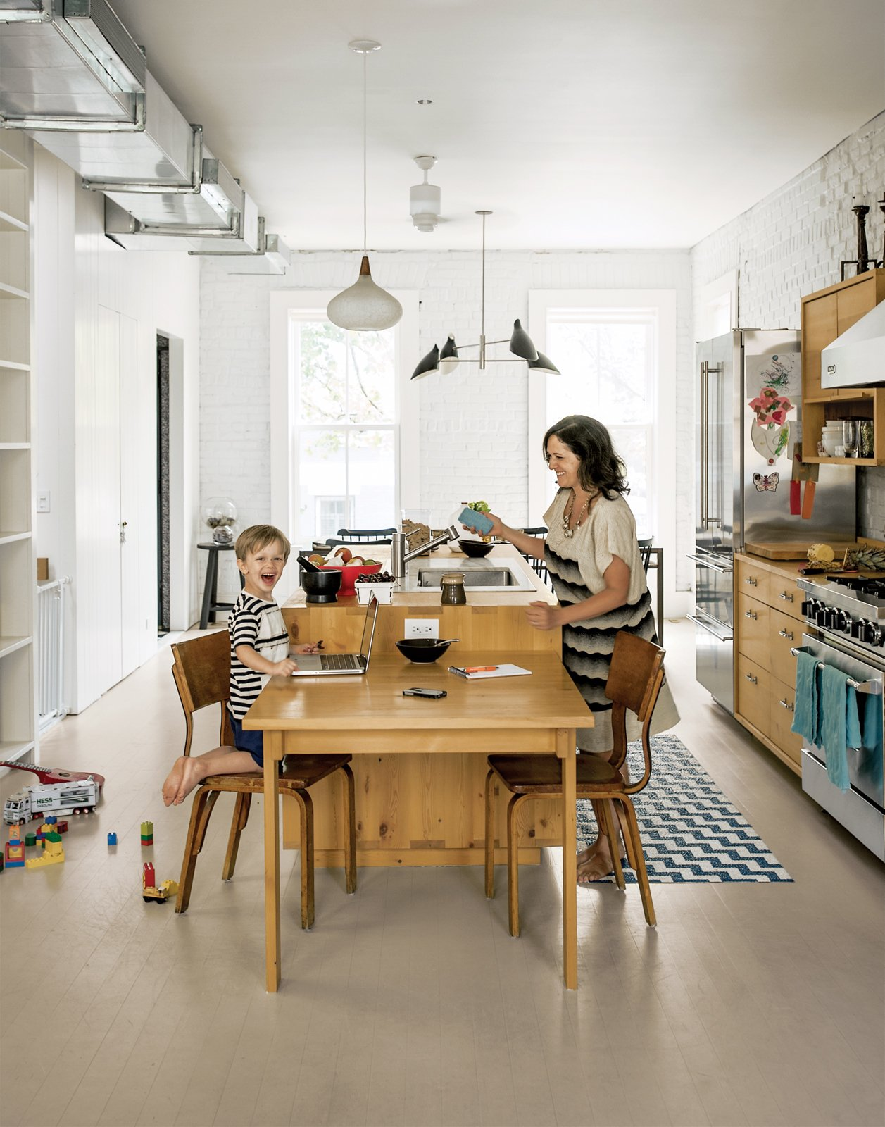 """Kitchen & Dining Room """"This room really became the heart of the space,"""" Dawn Casale says. """"If people are sitting at the dining table or in the living area, you're able to have a really free-flowing conversation and there's a nice dynamic happening on the entire floor."""""""
