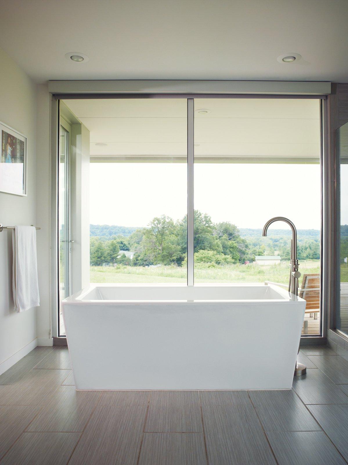 #bath #spa #bath&spa #modern #interior #bathtub #farmhouse #missouri #porchhouse #hufftprojects   Photo courtesy of Joe Pugliese Tagged: Bath Room, Ceramic Tile Floor, and Freestanding Tub.  Photo 2 of 22 in Bath & Spa Intrigue