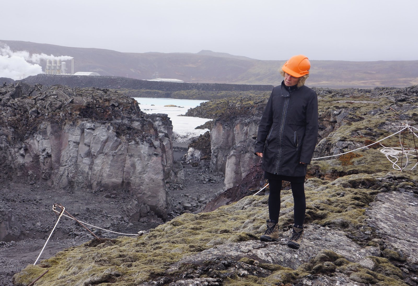 """Architect Sigríður Sigþórsdóttir of BASALT Architects surveys the environment. """"She knows every inch of this land,"""" says Sigurdur Thorsteinsson of Design Group Italia, who has worked with the architect on the site for the past 20 years.  Photo 3 of 5 in Dive Into the Next Phase of Iceland's Blue Lagoon"""