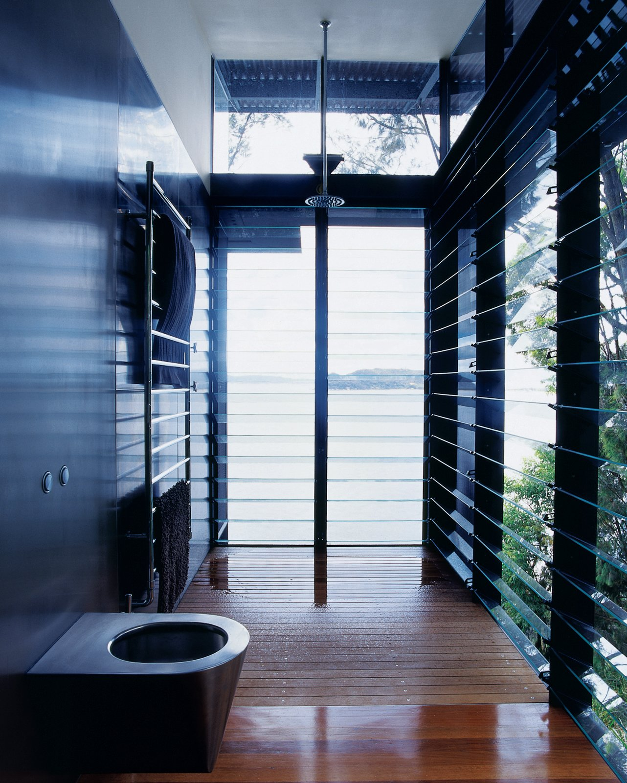 Even the master bath is open to the surrounding water. Tagged: Bath Room, Medium Hardwood Floor, and Open Shower.  Photo 11 of 11 in Three Glass-and-Copper Pavilions Conquer the Cliffs