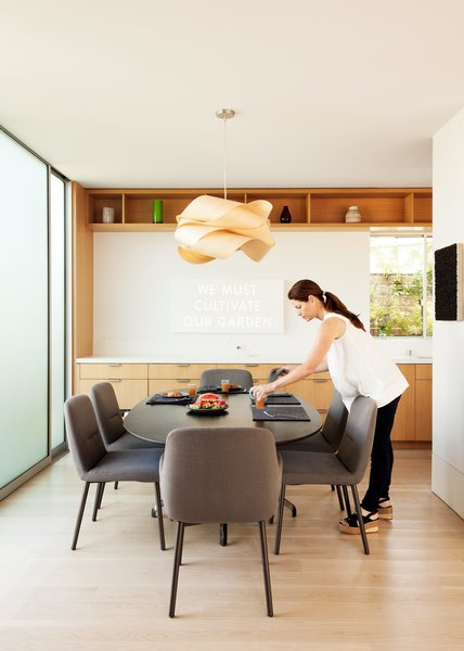 A EuroStone countertop structures the open-plan kitchen and dining room, where the family will often gather and play.