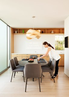 Amid a Hotbed of Architecture, This Home Holds Its Own - Photo 8 of 9 - A EuroStone countertop structures the open-plan kitchen and dining room, where the family will often gather and play.