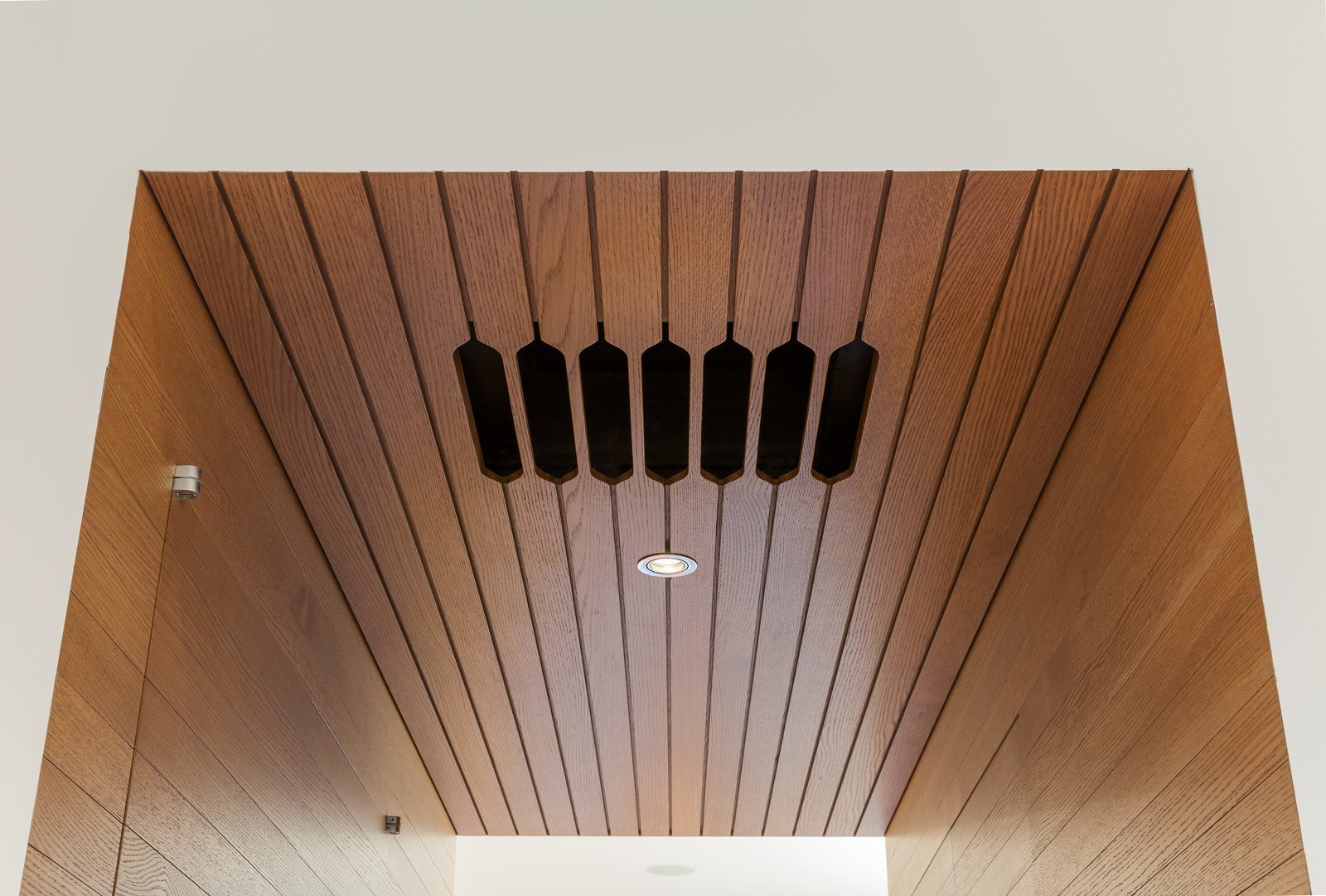 Addional lighting options in the kitchen include diffuse Bartco fluo-rescent strips hidden in coves overhead.
