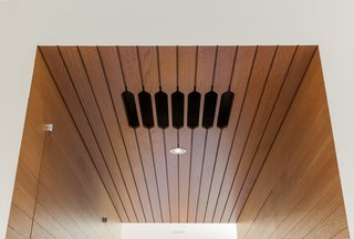 Addional lighting options in the kitchen include diffuse Bartco fluorescent strips hidden in coves overhead.
