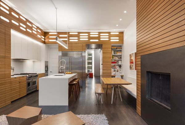 Lutron smart controls manage the new kitchen's abundance of lighting options, including an Axis twin-beam pendant that hangs directly over the island.