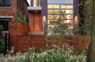 Thanks in part to landscape architect James C. Differding, the residents can enjoy the outdoors on all four levels, from the pocket garden that buffers the house from the street to the rooftop enclave.