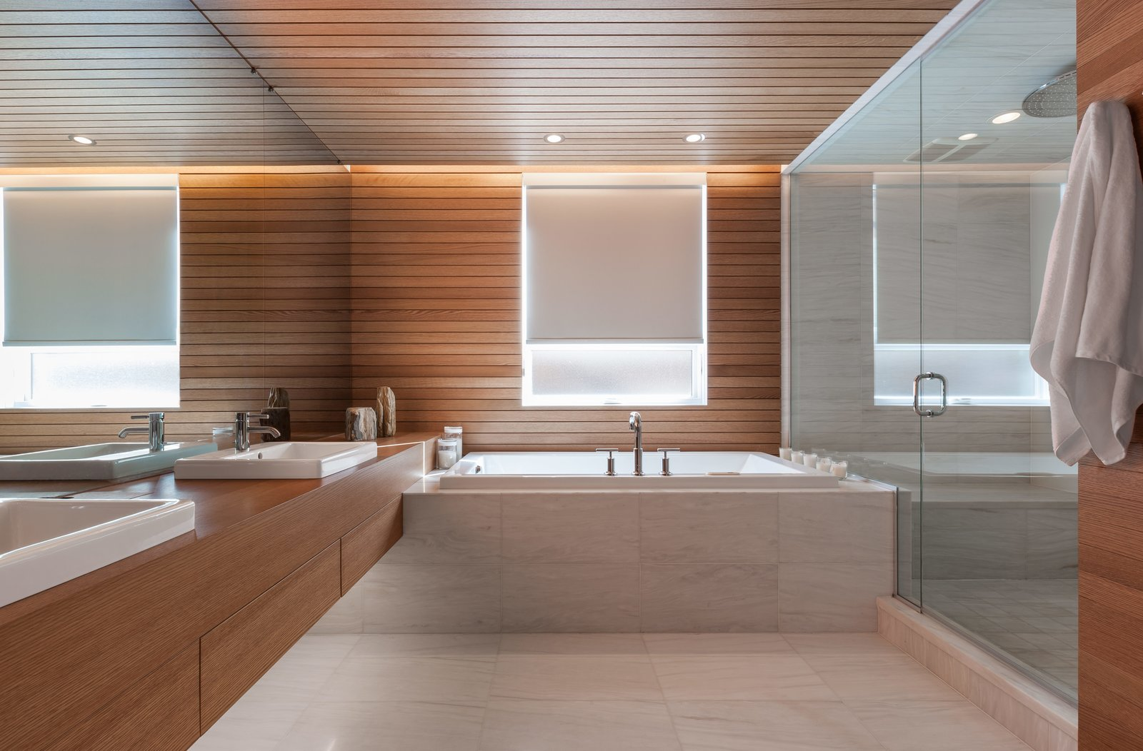 The bathrooms saw the least significant changes. In the one nearest to the master bedroom, the shower and tub are original. White oak paneling provides continuity between the newly renovated spaces. Tagged: Bath Room, Wood Counter, Soaking Tub, Drop In Sink, Enclosed Shower, and Ceiling Lighting. Four Floors of Gadgets and Gardens in Chicago - Photo 13 of 17