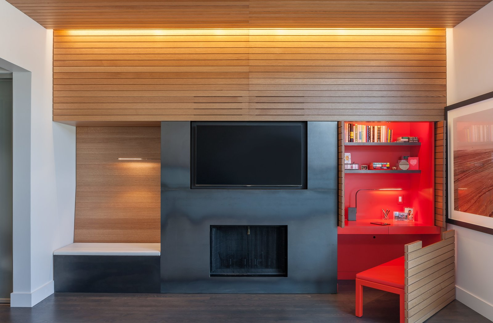 In the office, doors slide back and a chair pulls out to reveal a custom built-in desk. Tagged: Living Room, Ceiling Lighting, Dark Hardwood Floor, Bench, and Standard Layout Fireplace.  Photo 10 of 17 in Four Floors of Gadgets and Gardens in Chicago