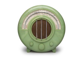 Remember When TVs Looked Like This? - Photo 1 of 5 - Ekco AD65 Radio Wells Coates designed the AD65 radio, shown here in a rare green version, for British electronics company Ekco in 1932. New technology made this wireless device possible, but it was the visual shift from wood cabinetry-like casing that made the piece stand out.