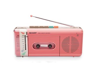 Remember When TVs Looked Like This? - Photo 4 of 5 - QT-50 Cassette Recorder This portable tape player and recorder by William Lansing Plum for Sharp, released in 1985, also played AM/FM radio. The colorful pastel shell and control buttons nodded to an emerging—and enduring—trend: electronics as personal fashion accessory.