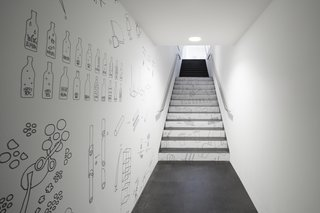 Nendo's Minimalism Meets Ron Arad's Sweeping Curves - Photo 7 of 7 - Oki Sato's sketches line a hallway and staircase in the museum.