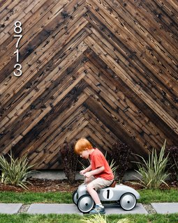 In Seattle's Greenwood neighborhood, architect Tiffany Bowie built an efficient house for her father, Dave, a retired engineer. A prototype system by Kirio monitors the home's energy use. Shou sugi ban cladding in a herringbone pattern provides a striking backdrop as Dave's grandson Aksel zooms past.