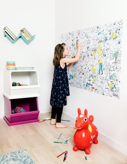 Guest rooms provide space for visiting grandchildren. Tiffany's daughter, Anouk, uses a bedroom wall to hold a work in progress.
