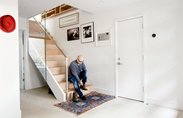 A glass panel was placed along the stair banister to create a transparent pathway for light to travel down from the second-floor skylight. Otherwise, Azevedo left the staircase mostly untouched, a rare exception in her to-the-studs renovation.