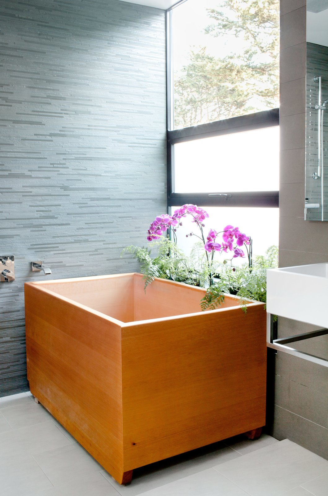 "One such vacation inspired the tub, made of aromatic hinoki wood, in the master bathroom. Tagged: Bath Room and Freestanding Tub.  Photo 11 of 12 in Two Silicon Valley Vets Master the Smart Home Without Going Full ""Jetsons"""