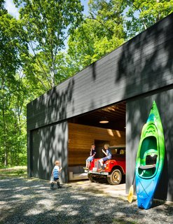 A Dwell Favorite: Relaxing Along the River - Photo 2 of 3 - The spacious detached garage stows a bevy of kayaks and inner tubes, not to mention the family car.