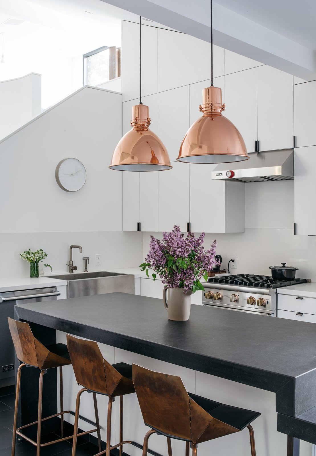 The kitchen is outfitted with a granite countertop and custom casework; the hardware is by Tom Kundig