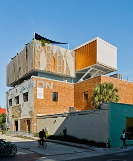 High Above Traditional Charleston, a Modern Home Finds its Roost - Photo 7 of 7 - Fiberglass composite louvers, which Rich can control from the deck, block out views from a nearby college dorm and parking garage.