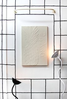 "There Are No Random Knickknacks at This Dollar Store - Photo 5 of 5 - A wall-mounted piece by Michael Assiff with lighting by Elise <span style=""line-height: 1.8;"">Elise McMahon</span><span style=""line-height: 1.8;"">.</span>"