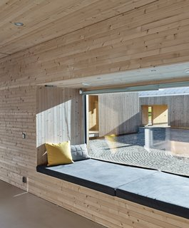This Battery-Powered House Never Runs Out of Juice - Photo 6 of 7 - A window seat provides a place to relax post-sauna.