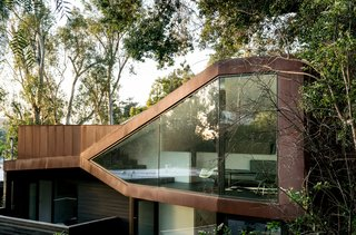 """This Los Angeles Home is Driven by Automotive Design - Photo 1 of 9 - Resident Richard Kim, who works as the head of design at electric car company Faraday Future, tested his know-how with the creation of his own Los Angeles home, a curvilinear structure clad in Cor-Ten steel and black-stained cedar. """"This house is different,"""" says Richard. """"It's as much a sculpture as it is a place to live."""""""