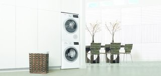 "Bosch's Streamlined Kitchen and Laundry Appliances Are Made for Small Spaces - Photo 5 of 6 - Joining the kitchen line, Bosch recently unveiled an efficient 24"" laundry pair. The units can be stacked vertically, further reducing their footprint in the home."