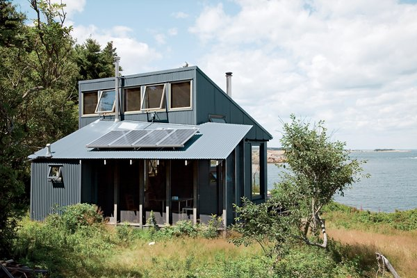 Constructed on land he had owned for years, this tiny cabin is also totally green.