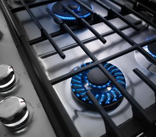 7 Kitchen Technologies to Watch - Photo 7 of 7 - The KitchenAid cooktop features a precise Torch Burner flame that makes it easy to adjust heat levels, from a small flame for simmering to a larger flame designed to distribute heat evenly. The surface is also coated in a finish that makes it a quick clean.