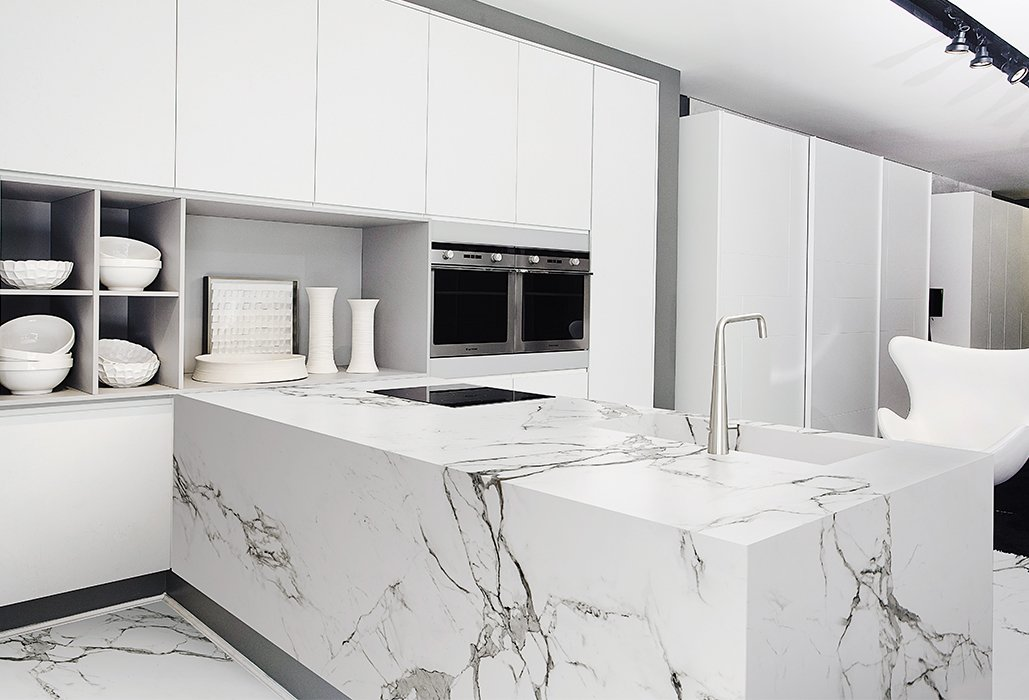 High-performance materials like Dekton by Cosentino are new alternatives for granite. The surface is scratch-resistant and easier to clean than stone. Tagged: Kitchen, Marble Counter, White Cabinet, Marble Backsplashe, and Marble Floor.  Photo 7 of 8 in New Kitchen Materials You Should Know About